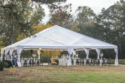 Tented wedding reception with clear tent
